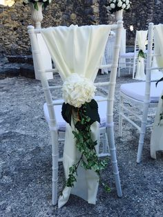 white flower on the chair, white cover chair, Sant'Eustachio, Villa Minuta, Scala, White, Yellow and Orange colors, Olga Studio, Sposa Mediterranea, Federica wedding Planner