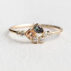 A very special release of our Around the Bend ring in the colorway Georgia  Peach sapphire asscher cut and deep hunter green garnet…