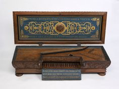 Virginals.  Place of origin: Flanders (region), Belgium (Made).  Date: 1568 (Made).  Artist/Maker: Unknown (Made).  Materials and Techniques: Carved walnut case; painted and gilded inside of the lid; painted sprunce soundboard.