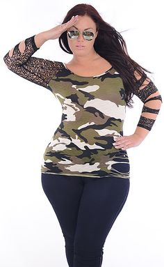 Scout out a point for seductive observation for this spicy shirt. The camo print fashion has a subtle textured accent and mesh, slash sleeves. One side of the hem has slashes and this item is light weight and we recommend a camisole or skin tone undergarments be worn.