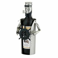 "Old Dutch Metal Ship's Captain Wine Bottle Holder Buddy by Old Dutch. $28.02. Made of Finished Steel with Matte Black Accents. Ship's Captain Wine Bottle Buddy. Designed to hold a 750 ml Wine Bottle. Also great for holding Beer Bottles or Olive Oil Bottles. Measures approx. 12"" Tall. Ship's Captain Wine Bottle Buddy (Holds 750ml bottle)Old Dutch Metal Ship's Captain Wine Bottle Holder Buddy"