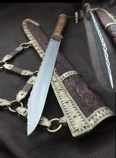 The Dog Seax.  Baltic war knife style with non-authentic file work on the back of the blade.
