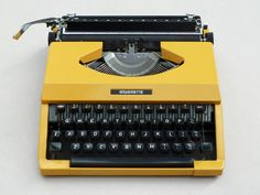 I love the tap-tap-tap of typewriter keys.  May have to buy one of these: Yellow Typewriter | Present /&/ Correct
