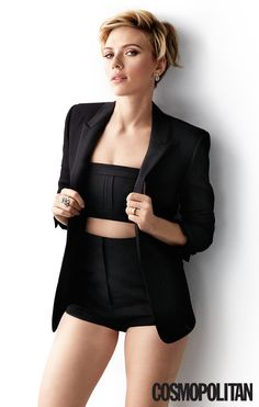 Scarlett Johansson poses in a black blazer, crop top and high-waisted shorts