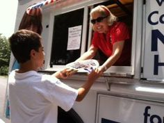 WJZY, the new home for FOX46 Carolinas handed out free ice cream across cities and towns across the Charlotte region this past weekend. Pictured is Karen Adams, VP General Manager of WJZY and a happy customer in Cornelius, NC