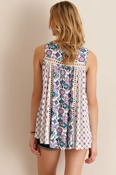 @knittedbelle #knittedbelle Multi print rayon flare blouse featuring crochet lace detailing throughout. Loose fit. Slightly sheer. Partially see-through. Woven. Lightweight.100% Rayon