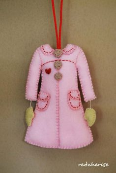 little pink coat with dangley mittens