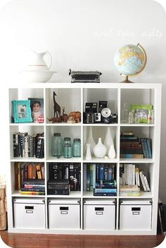 Love the organization of the shelves with each cubby holding a different passion/collection.