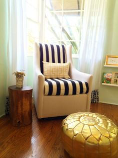 This @Elise West elm Graham Glider is the perfect addition to this nursery and we love the striped @IKEA USA blanket tucked in (protects the chair and looks fab)! #nursery