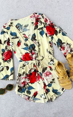 Let the floral romper kill boring time. Catch it now, $17.99! Plunging neckline is sexy for summer, and the floral is perfect for a rooftop party.