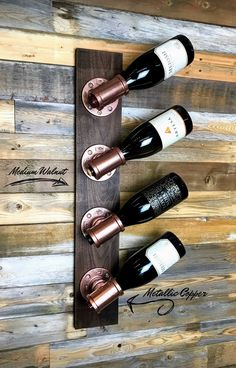 This unique custom wine rack is made of industrial iron pipe fittings using premium select walnut and cherry woods for the base. Best Picture For DIY Wine Rack over refrigerator For Your Taste You are Wine Rack Design, Wood Wine Racks, Diy Wine Racks, Unique Wine Racks, Pallet Wine Racks, Wine Rack Wall, Iron Wine Rack, Wood Rack, Wine Crates