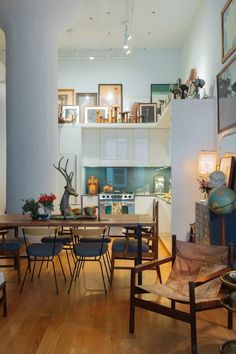 """Gallery walls are nice, sure, but let's go ahead and coin this the """"gallery loft"""" and start coveting it now."""