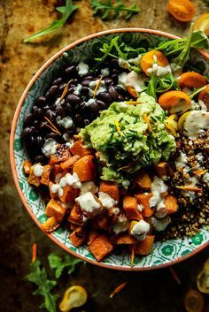 This looks so good! Black beans, guacamole, sweet potatoes and a spicy lemon dressing. Perfect vegan salad