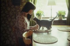 a girl and her cat. it's an universal prettiness! from annette pehrsson.