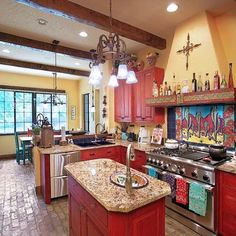 omg I'm in love...red cabinets....would be perfect if they were turquoise distressed with the red under...
