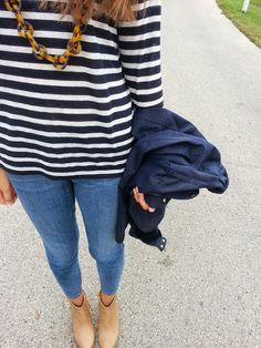 Striped shirt and tortoiseshell necklace.