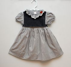 SALE: Vintage grey striped girl's dress. $14.00, via Etsy.