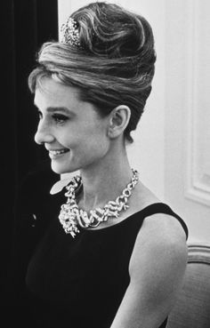 """The Tiffany Yellow Diamond is one of the largest yellow diamonds ever discovered; it weighed 287.42 carats (57.484 g). The diamond is known to have been worn by only two women during its lifetime. It was worn by Mrs. Sheldon Whitehouse at the 1957 Tiffany Ball held in Newport, Rhode Island, mounted for the occasion in a necklace of white diamonds. It was subsequently worn by the actress Audrey Hepburn in 1961 for the publicity photos of John Springer for the movie """"Breakfast at Tiffany's""""."""