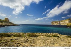 Bay of Xlendi close to Victoria, the capital of Gozo Island, Malta - It is one of the prettiest villages on the island flanked by inky blue sea, cloudless turquoise sky and majestic cliffs that afford wonderful views for the adventurous...