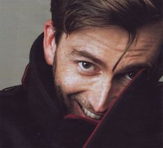 David Tennant -- Do I sense the slightest bit of mischief in that smile? <---- He's probably thinking, 'After the shoot, I'm gonna take that camera...'