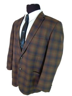 Vintage1960s summer weight plaid sport coat with skinny lapels. Made to measure by Schaefer.