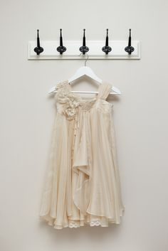 www.pinkandgrey.com.au, Florence Dress. A timeless silk Georgette dress with a delicate empire line French Chantilly lace bodice. Embellished with silk flowers, delicate organic cotton lace, Swarovski pearl detail and rouleaus cascading down the right side. A soft and floaty draped skirt, perfect for twirling. Finished with a silk satin bow at the back.