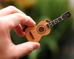 Cute ukulele necklace, with strings and everything!