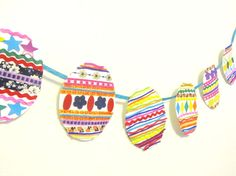 Create your own colorful Easter Banner with the kids!  You can use scrap paper and leftover craft materials to make a beautiful holiday garland.  http://www.greenkidcrafts.com/easter-egg-garland/
