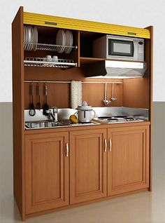 Mini-Kitchen ideas for your tiny - These are too cool!Redoing an Rv?Think about this for the kitchen! I like the dish storage and the space to hang your utensils. Space saving designs for the win!: