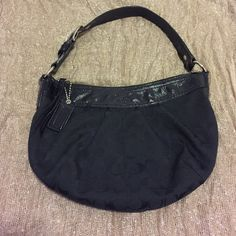 PRICE DROP🎉🎉Small Coach Purse This is a small purse, fitting over the shoulder and just under the arm. The classic Coach print is on the exterior in black, with a patent leather strap that also covers the top of the purse. The back has a zipper pocket and the inside does as well. The inside also has two open pockets for small items like your phone. The interior material is grey. Coach Bags Shoulder Bags
