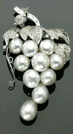 WHITE GOLD, CULTURED PEARL AND DIAMOND BROOCH/PENDANT DESIGNED AS A BUNCH OF GRAPES EMBELLISHED WITH A LITTLE SNAIL