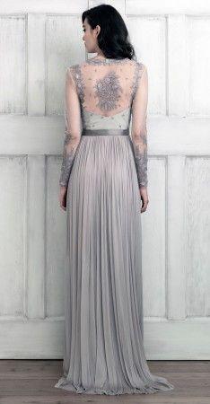 Gorgeous back detail on this dress. Elegant. Flowy.