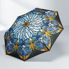 Stained Glass Butterfly Umbrella~ I'd be tempted to cut the black parts out, though. Should still work properly.