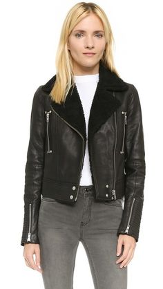 A cool Paige Denim leather moto jacket trimmed in soft shearling. Perfect for wearing solo, or with light layering underneath.