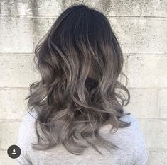 25 Best Hairstyle Ideas For Brown Hair With Highlights: black, medium length wavy hair with silver ombre gradient
