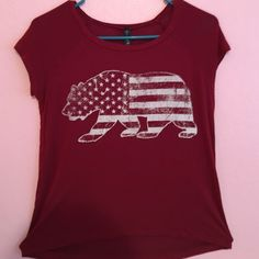 Maroon tillys bear shirt Maroon colored in very good condition I will iron it has no pockets or holes and is very soft the picture has a bear with an American flag in it Tilly's Tops Crop Tops