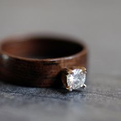 Wonderful spin on the ring! Love!! Wooden Moissanite Ring Ebony with 4mm by NorthWoodRings on Etsy,