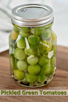 These spicy Pickled Green Tomatoes are a quick and easy way to use up the last of your garden's harvest! These green cherry tomatoes are pickled with vinegar, garlic, dill and red pepper for a tasty bite size refrigerator pickle. Canning Green Tomatoes, Green Tomato Relish, Pickled Green Tomatoes, Green Tomato Recipes, Canning Vegetables, Tomato Ideas, Veggies, Cabbage Recipes, Pickled Cherries