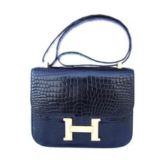 Hermes Constance H Flap Bag Black Shiny Crocodile Gold HDW 23 cm | From a collection of rare vintage evening bags and minaudières at https://www.1stdibs.com/fashion/handbags-purses-bags/evening-bags-minaudieres/