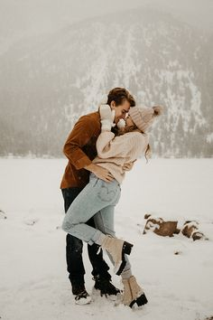 Cozy, warm sweaters and cute heeled boots are the perfect fit for winter engagement photos!