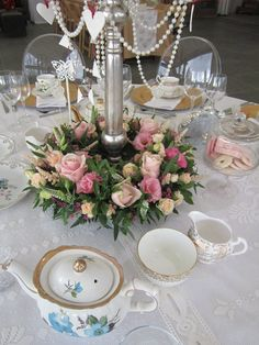 Flowers around your Candelabra in dusky pinks , soft peaches and creams for a vintage look wedding