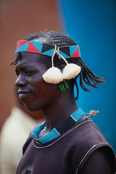 Africa | Banna man proudly wearing his newly purchased headband, at the local market. Dimeka, Ethiopia | ©Ingetje Tadros