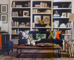 White Bookcase With Navy Backs, Art Installed Within A Bookcase Bay, Nice  Compliment. Living Room ...