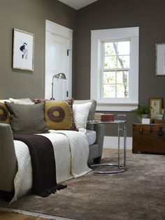 I love the wall color, especially against the white. Makes me a little tempted to paint my living room, this looks cozy!
