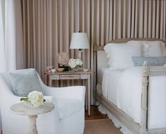 love the colors- pale peach-beige-creme against white, pale blue.  fabric behind bed.  very restful
