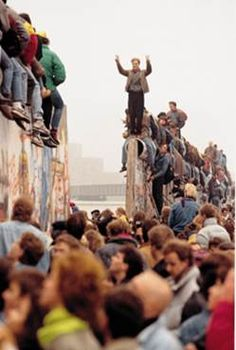 Fall of the Berlin Wall in 1989; East Germans stream in West Germany