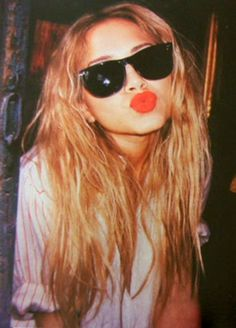 Olsen - big glasses and red lips