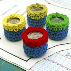 Make colorful crocheted sewing pattern weights with yarn scraps and pocket change!