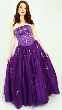Oh so elegant purple wedding dress.  See more purple wedding inspiration: http://www.squidoo.com/purple-themed-wedding
