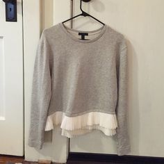 Shirt J Crew long sleeved shirt with ruffle/pleated bottom. Sweatshirt material but not hot sweatshirt material if that makes sense? Super cute unique shirt. Great condition nothing wrong with it! J. Crew Tops Tees - Long Sleeve